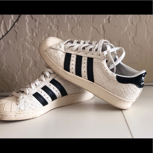 adidas Shoes - Off white snake skin textured Adida shell toes.
